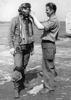 A Member From The Personal Equipment Office Inspects The Oxygen Equipment Worn By A Pilot Of The 353rd Fighter Group, Based In England. 27 May 1945.