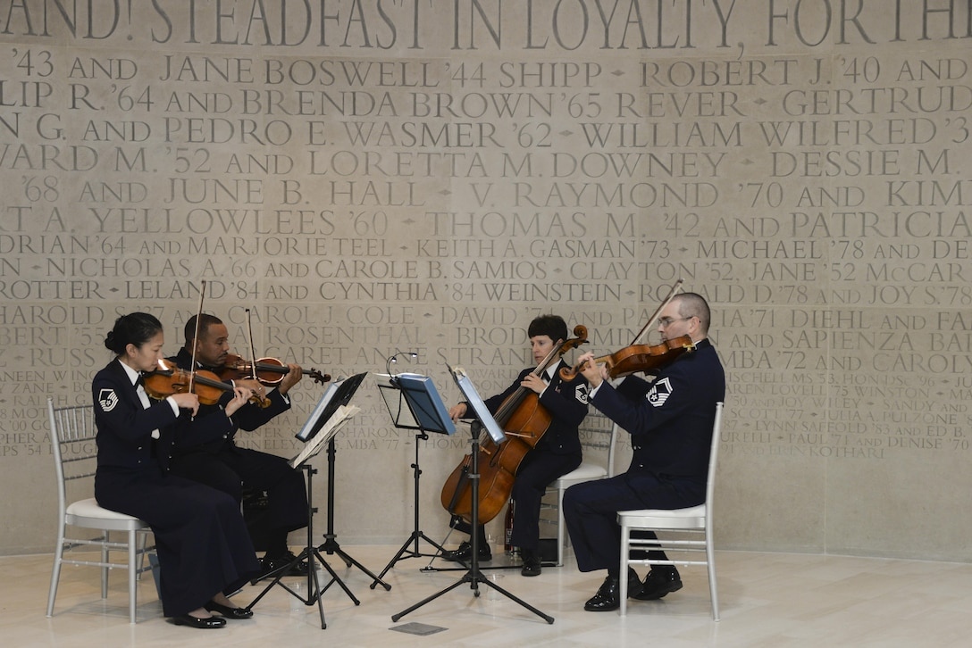 The United States Air Force Band, Air Force Strings members play in a rotunda during the Fort Meade Air Force Birthday Celebration at College Park, Md. September 15, 2017. This year's celebration was hosted by the 70th ISRW with the theme Breaking Barriers: Sound, Cyber and Beyond. (U.S. Air Force photo by Staff Sgt. Alexandre Montes)
