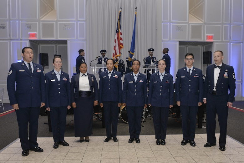 Members of the Baron 52 sing the national anthem as the Base Honor Guard presents the colors during the beginning of the Fort Meade Air Force Birthday Celebration at College Park, Md. September 15, 2017. This year's celebration was hosted by the 70th Intelligence, Surveillance and Reconnaissance Wing, with the theme Breaking Barriers: Sound, Cyber and Beyond. (U.S. Air Force photo by Staff Sgt. Alexandre Montes)