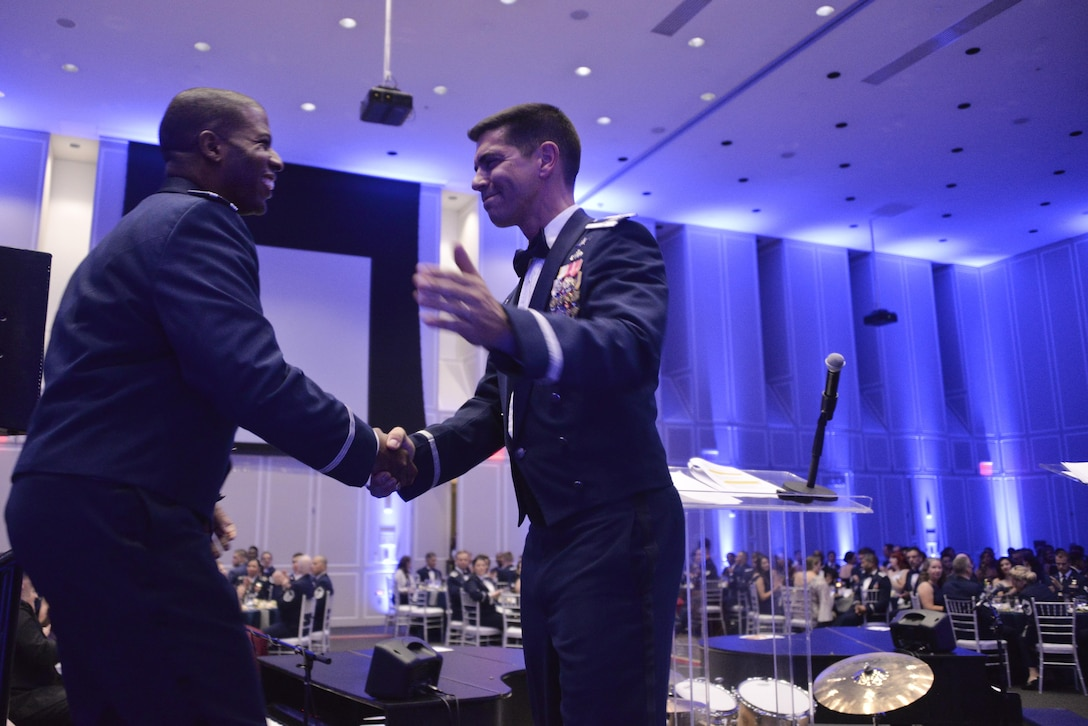 Major Kenyatta Ruffin, Airpower Strategist at Headquarters Air Force, Pentagon is greeted by Col. Matteo Martemucci, 70th Intelligence, Surveillance and Reconnaissance Wing commander, during the Fort Meade Air Force Birthday Celebration at College Park, Md. September 15, 2017. This year's celebration was hosted by the 70th ISRW with the theme Breaking Barriers: Sound, Cyber and Beyond. (U.S. Air Force photo by Staff Sgt. Alexandre Montes)