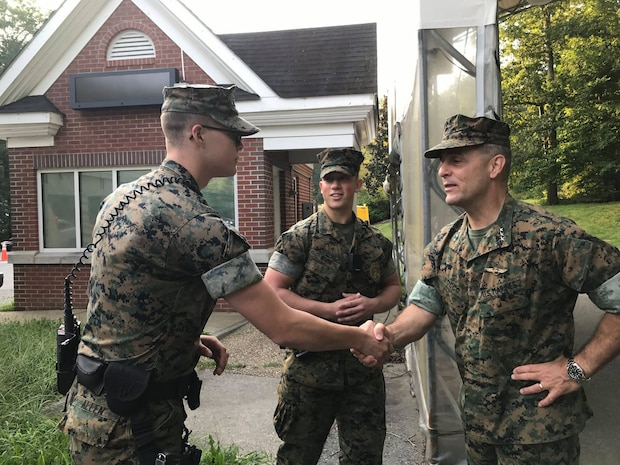 Lt. Gen. Michael Rocco, deputy commandant for Manpower and Reserve Affairs joined Marines from Security Battalion, LCpl Bryce W. Allen (left) and  LCpl Brandon L. White (right) Aug. 31 at the main gate to wish a happy and safe Labor Day weekend to service members and civilians entering the base.  They took the opportunity to hand out resource information related to September's National Suicide Prevention Awareness Month.