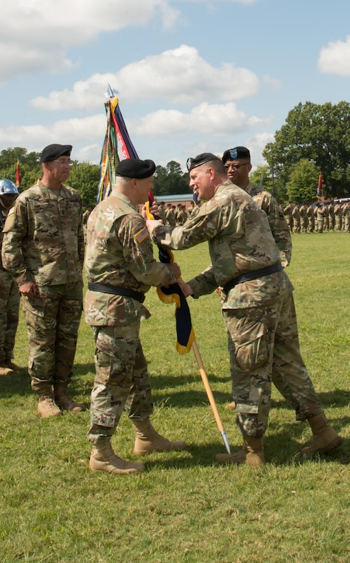 (Left) Incoming Commander of the 80th Training Command Maj. Gen. Bruce E. Hackett receives the unit's colors from Deputy Commanding General of the U.S. Army Reserve Command Maj. Gen. Scottie D. Carpenter at the 80th's change of command ceremony at Fort Lee, Virginia, Sept. 17, 2017.
