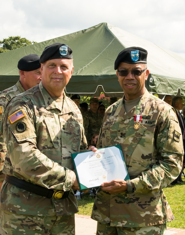 (Left) Deputy Commanding General of the U.S. Army Reserve Command Maj. Gen. Scottie D. Carpenter presents outgoing Commander of the 80th Training Command Maj. Gen. A.C. Roper with the Distinguished Service Medal at the 80th's change of command ceremony at Fort Lee, Virginia, Sept. 17, 2017.