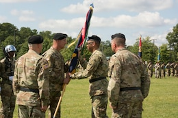 (Second from left) Command Sgt. Maj. Jeffrey Darlington, command sergeant major of the 80th Training Command, hands the unit's colors to outgoing commander Maj. Gen. A.C. Roper at the 80th's change of command ceremony at Fort Lee, Virginia, Sept. 17, 2017.