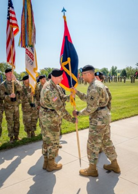 Left, newly promoted Brig. Gen. Michael Harvey receives the colors from Maj. Gen. A.C. Roper, signifying his taking command of the 102nd Training Division during a ceremony held Sept. 9 on Fort Leonard Wood's MSCoE Plaza.