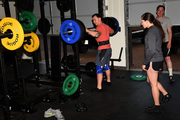 PETERSON AIR FORCE BASE, Colo. – SSgt. Cerrissa Witte, 21st Medical Operations Squadron staff noncommissioned officer physical therapy, works with an EOD member doing barbell squats at their workout facility on Peterson Air Force Base, Colorado, Sept. 14, 2017. Witte works with EOD to ensure they are physically qualified to perform their mission. (U.S. Air Force photo by Robb Lingley)