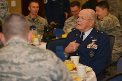 U.S. Air Force Retired Brig. Gen. Richard Abel listens to his wingman speak during a POW/MIA Recognition Day breakfast at Joint Base Langley-Eustis, Va., Sept. 15, 2017.