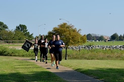 The last group of volunteers run to Memorial Park to hand off the POW/MIA flag at the end of the 24-hour vigil run at Joint Base Langley-Eustis, Va., Sept. 15, 2017.