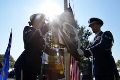 Langley Air Force Base Honor Guard members raise the POW/MIA flag during the POW/MIA Remembrance Day ceremony at Joint Base Langley-Eustis, Va., Sept. 15, 2017.