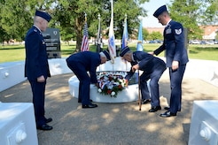 (From center left) U.S. Retired Lt. Gen. Glen Moorhead III and U.S. Air Force Retired Brig. Gen. Richard Abel place a wreath on the memorial in observance of National POW/MIA Recognition Day at Joint Base Langley-Eustis, Va., Sept. 15, 2017.