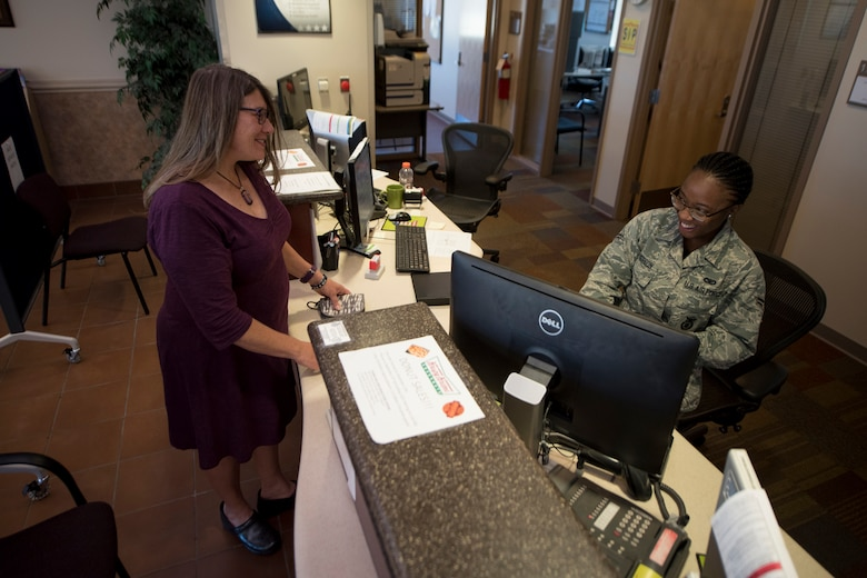 Karin Steadman receives her base access identification card at the Visitor Center on Peterson Air Force base, Colorado, Sept. 15, 2017. Through the Gold Star Base Access ID Program, Gold Star immediate family members of fallen Airmen can obtain log-term access cards to Air Force bases to access cemeteries, attend base events and receive additional services provided by the Airman & Family Readiness Center. (U.S. Air Force photo by Senior Airman Dennis Hoffman)