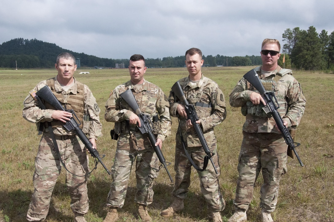 Members of the 416th Theater Engineer Command Marksmanship Team, show their M-16A2 rifle as they begin to compete in the 2017 Army Reserve Small Arms Championship.