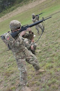 Sgt. Andrew Newlon, Winslow, Arkansas, and a combat engineer with the 688th Engineer Company (Mobility Augmentation Company), Harrison, Arkansas, competes during the M-16A2 portion of the Army Reserve Small Arms Championship.