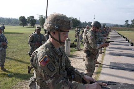 Sgt. Andrew Newlon, from Springfield, Missouri, a combat engineer with the 688th Engineer Company (Mobility Augmentation Company), Harrison, Arkansas, competes during the M-9 portion of the Army Reserve Small Arms Championship.