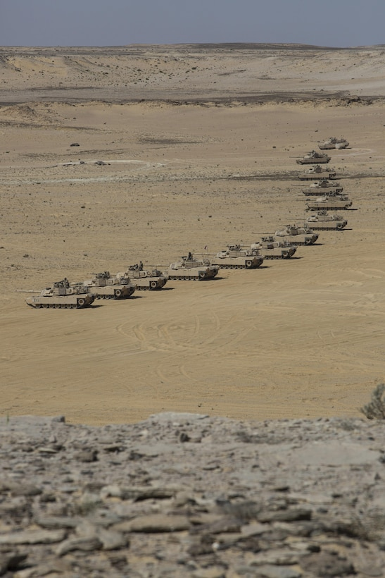 A column of U.S. Army M1A2 Abrams tanks from the 2nd Battalion, 7th Cavalry Regiment, 3rd Armored Combat Team, 1st Cavalry Division, await the star of the final combined arms live fire exercise of Bright Star 2017. Exercise Bright Star 2017 is a bilateral U.S. Central Command command-post exercise, field training exercise and senior leader seminar, held with the Arab Republic of Egypt. Participation strengthens military-to-military relationships between U.S. and Egyptian forces in the Central Command area of responsibility. The exercise enhances regional security and stability by responding to modern-day security scenarios. (U.S. Department of Defense photo by Tom Gagnier)