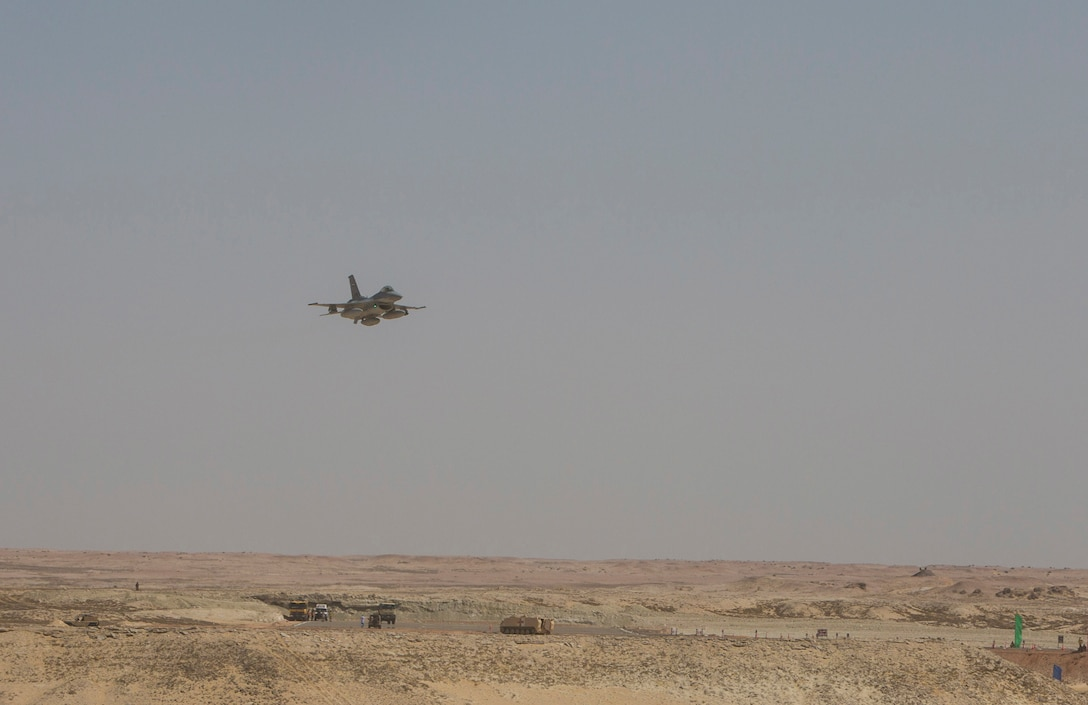 An Egyptian F-16 fighter jet flies toward a simulated battlefield during the final combined arms live fire exercise of Bright Star 2017. Bright Star is a combined command-post and field training exercise aimed at enhancing regional security and stability by responding to modern day security scenarios with the Arab Republic of Egypt. (U.S. Department of Defense photo by Tom Gagnier)