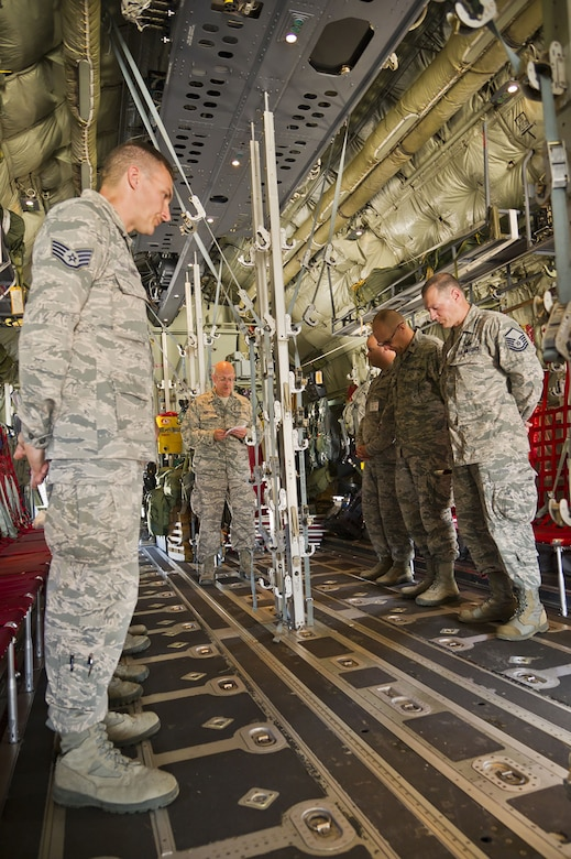 (Far right) Master Sgt. Terry Reisinger, 445th Airlift Wing Chaplain Corps superintendent, chapel operations, joins fellow U.S. Air Force chaplains and their assistants as they conduct a mock dignified transfer performed by Chaplain (Lt. Col.) Larry Henderson, 307th Bomb Wing Chaplain Corps, Barksdale Air Force Base, Louisiana, inside a 130J Super Hercules aircraft during exercise Patriot Warrior at Volk Field Air National Guard Base, Wisconsin, August 19, 2017.