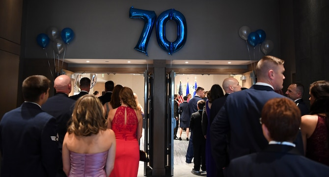 Buckley members and their spouses gathered in celebration of the 70th anniversary of the U.S. Air Force becoming its own branch of service. (U.S. Air Force photo by Airman 1st Class Holden S. Faul/ Released)