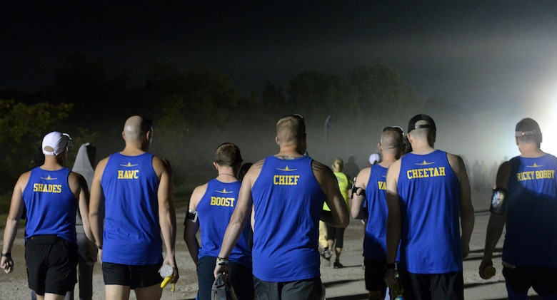 Several service members and their families from Columbus Air Force Base, Mississippi, walk toward the starting location of the Air Force Marathon Sept. 16, 2017, at Wright-Patterson AFB, Ohio. Each athlete completed the marathon in under five hours. (U.S. Air Force photo by Airman 1st Class Keith Holcomb)