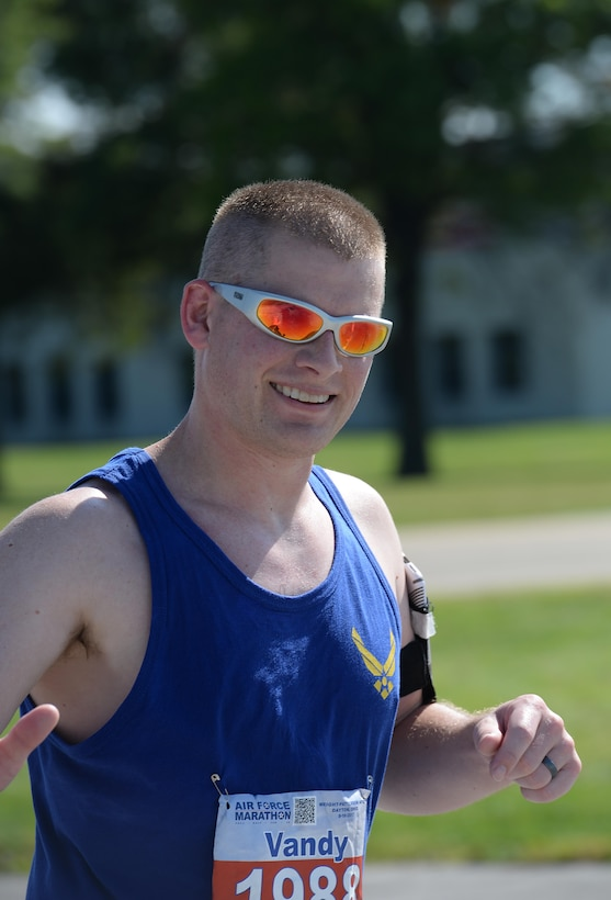 Capt. John Vandervoort, 41st Flying Training Wing Executive Officer, runs the last mile of the Air Force Marathon Sept. 16, 2017, on Wright-Patterson Air Force Base, Ohio. Vandervoort had the fastest time of all the Team BLAZE members who ran the Air Force Marathon, with a time of 4:24:08. (U.S. Air Force photo by Airman 1st Class Keith Holcomb)