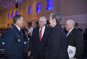 From left, Air Force Chief of Staff Gen. David L. Goldfein, Defense Secretary Jim Mattis, Secretary of the Air Force Heather Wilson and Air Force Association chairman F. Whitten Peters confer during the Air Force Association's Air, Space and Cyber Conference
