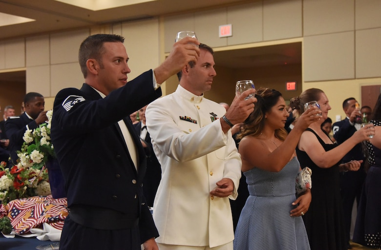 Keesler personnel hold their glasses up for a toast during the U.S. Air Force 70th Birthday Ball at the Bay Breeze Event Center Sept. 16, 2017, on Keesler Air Force Base, Mississippi. The event, hosted by the 81st Training Wing and the John C. Stennis Chapter of the Air Force Association, also paid tribute to all prisoners of war and military members still missing in action. (U.S. Air Force photo by Kemberly Groue)