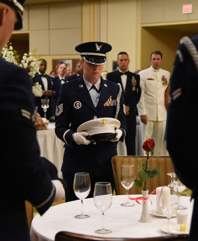 Tech. Sgt. Heather Starnes, Keesler Honor Guard member, participates in a POW/MIA table ceremony during the U.S. Air Force 70th Birthday Ball at the Bay Breeze Event Center Sept. 16, 2017, on Keesler Air Force Base, Mississippi. The event, hosted by the 81st Training Wing and the John C. Stennis Chapter of the Air Force Association, also paid tribute to all prisoners of war and military members still missing in action. (U.S. Air Force photo by Kemberly Groue)