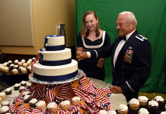 Airman Jacquelyn Gucciardi, 81st Medical Operations Squadron medical technician, and Retired Lt. Col. Dick Wilson, participate in a cake cutting ceremony during the U.S. Air Force 70th Birthday Ball at the Bay Breeze Event Center Sept. 16, 2017, on Keesler Air Force Base, Mississippi. The event, hosted by the 81st Training Wing and the John C. Stennis Chapter of the Air Force Association, also paid tribute to all prisoners of war and military members still missing in action. (U.S. Air Force photo by Kemberly Groue)