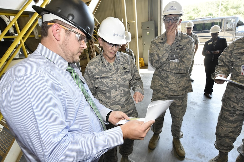 Jonathan Osborne, HTCI Project Manager and Technical Lead at Arnold Air Force Base (left) speaks with Gen. Ellen M. Pawlikowski, Air Force Materiel Command commander (center) and Col. Scott Cain, AEDC commander (right), regarding the transformation of the AEDC J-5 test facility into a facility that will support future hypersonic system weapon acquisition and research and development programs. (U.S. Air Force photo/Rick Goodfriend)