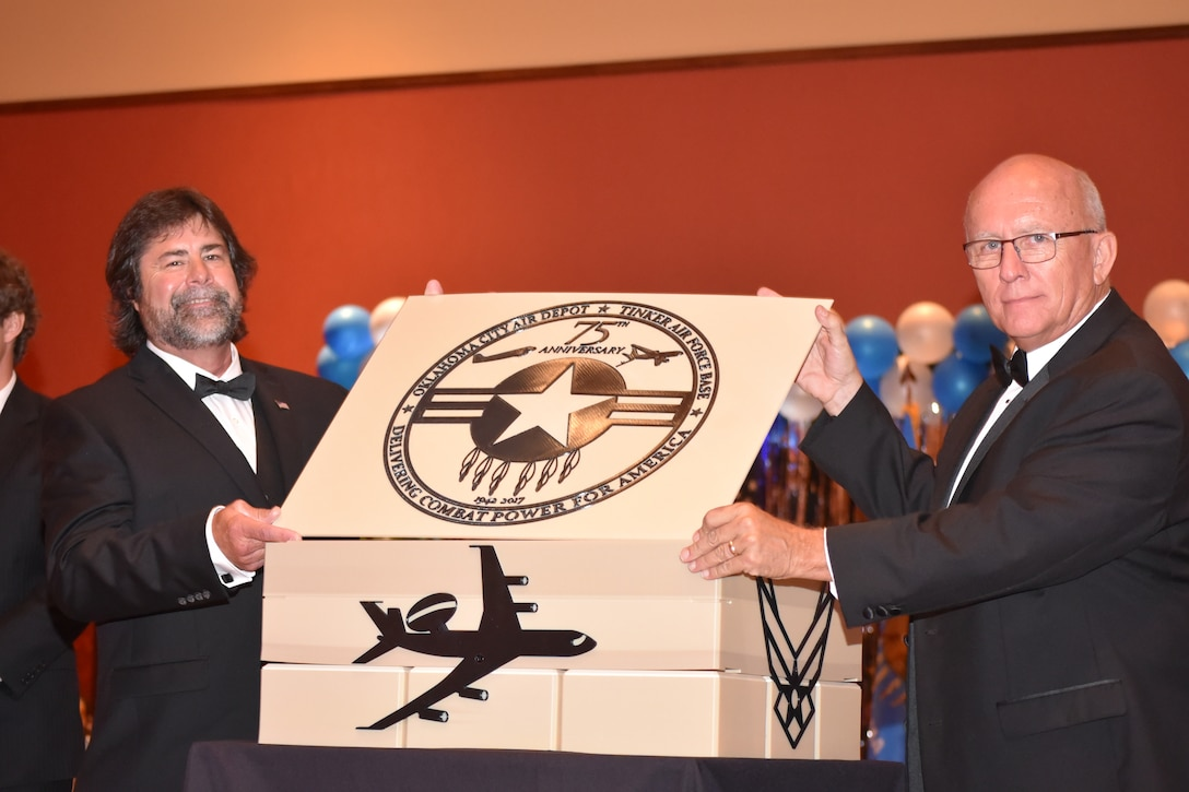 Phil Tinker, grandson of Maj. Gen. Clarence Tinker, and Jim Diehl, president of the Tinker Heritage Foundation, place the lid on top of the 75th anniversary time capsule during the 2017 Air Force Ball, held on Sept. 16 at the Embassy Suites Hotel in Norman, Oklahoma.