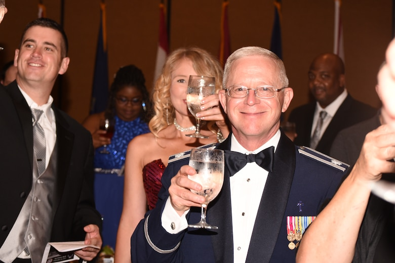 While attending the Air Force Ball last Saturday, Chaplain (Lt. Col.) Sam Tucker raised his glass during the toasts.