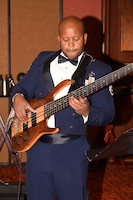 "Staff Sgt. Henry C. Roberson III, OPS Rep and bassist with The Band of the West's ""Velocity Combo."""