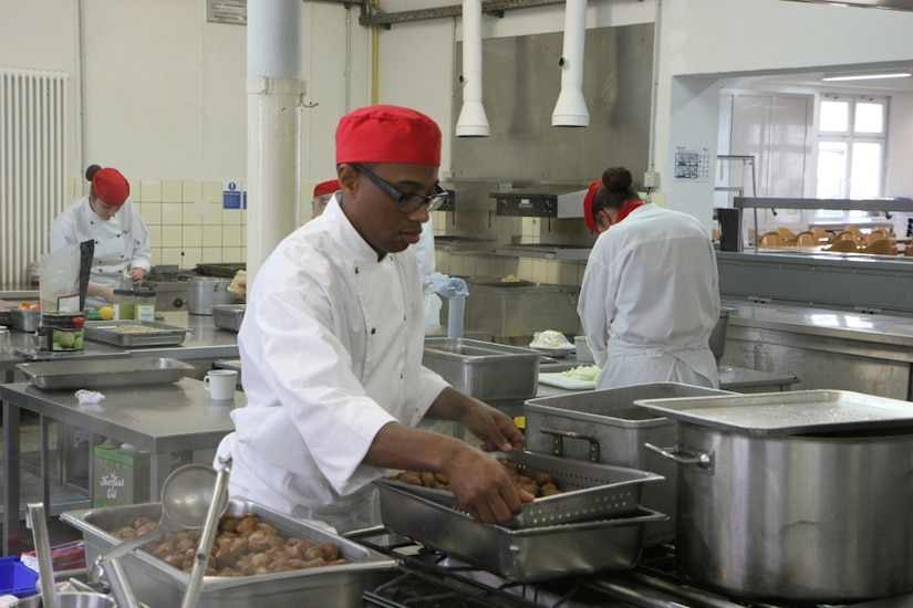 Cooks prepare food in one of the kitchens located at Sennelager Training Area, Germany.