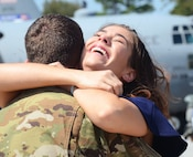 A woman embraces a returning deployer on the flightline at Dobbins Air Reserve Base, Ga. Sept. 18, 2017. Aircrews and aircraft maintainers returned to Dobbins after a four-month deployment to the Middle East in support of contingency operations. (U.S. Air Force photo/Don Peek)