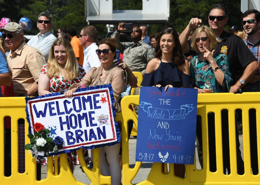 Families and friends of returning deployers prepare to greet their loved ones at Dobbins Air Reserve Base, Ga. Sept. 18, 2017. Four aircraft, along with their aircrews, returned to the 94th Airlift Wing after a deployment to Al Udeid Air Base, Qatar. (U.S. Air Force photo by Staff Sgt. Miles Wilson)