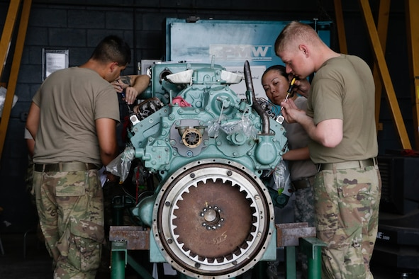 "U.S. Army Soldiers assigned to the 558th Transportation Company, 10th Transportation Battalion, 7th Transportation Brigade (Expeditionary) adjust the governor and fuel injector rack on a Detroit Diesel 12V-71 watercraft engine during the company's first ""Maintenance Rodeo"" competition at Third Port, Joint Base Langley-Eustis, Va., Sept. 19, 2017."