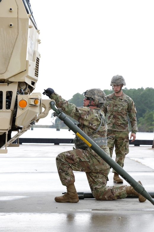 "U.S. Army Soldiers from 558th Transportation Company, 10th Transportation Battalion, 7th Transportation Brigade (Expeditionary) perform vehicle recovery actions in two Light Medium Tactical Vehicles during the company's first ""Maintenance Rodeo"" competition at Third Port, Joint Base Langley-Eustis, Va., Sept. 19, 2017."