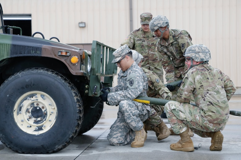 "U.S. Army Soldiers from the 558th Transportation Company, 10th Transportation Battalion, 7th Transportation Brigade (Expeditionary) perform vehicle recovery in two High Mobility Multipurpose Wheeled Vehicles during the company's first ""Maintenance Rodeo"" competition at Third Port, Joint Base Langley-Eustis, Va., Sept. 19, 2017."