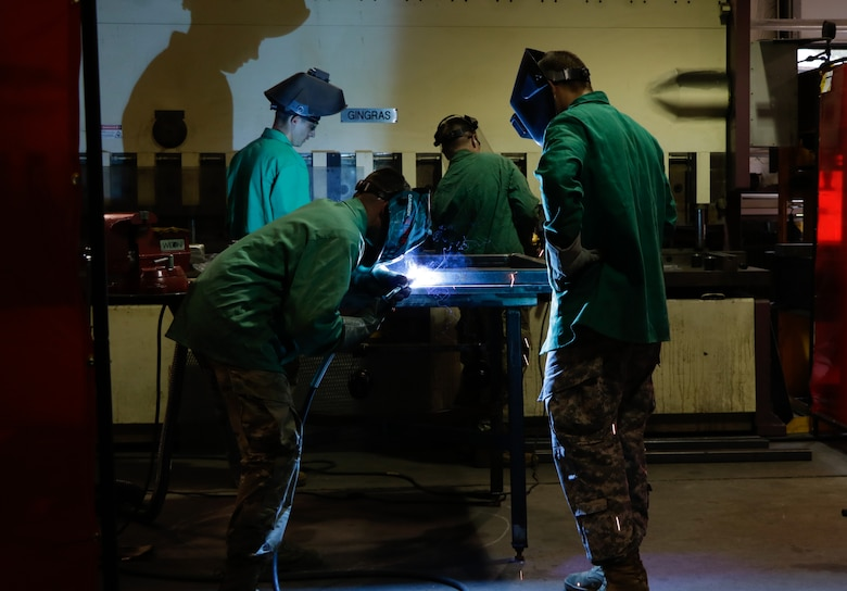 "U.S. Army Soldiers from the 558th Transportation Company, 10th Transportation Battalion, 7th Transportation Brigade (Expeditionary) conduct welding operations and fabricate an outdoor bench during the company's first ""Maintenance Rodeo"" competition at Third Port, Joint Base Langley-Eustis, Va., Sept. 19, 2017."