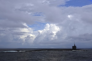 The ballistic missile submarine USS Tennessee transits on the surface of the Atlantic Ocean