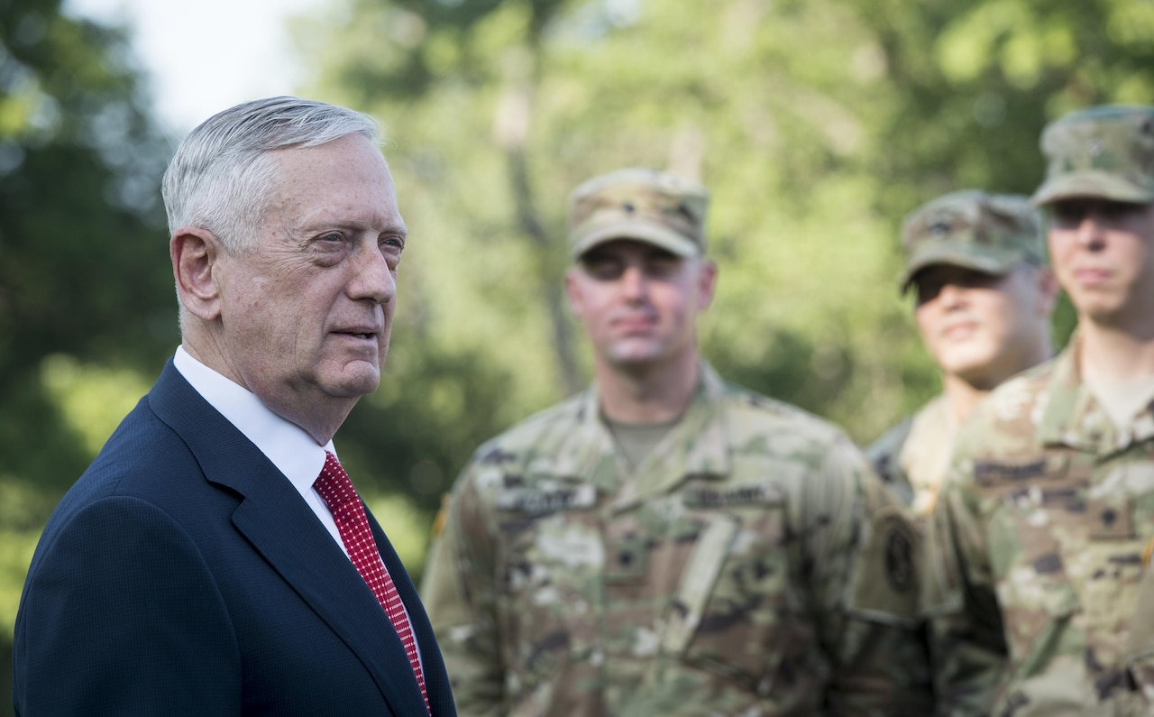 Defense Secretary Jim Mattis stands with a group of soldiers.