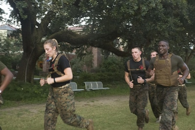 Marine Corps Cpl. Dejurne McCall (right), an administrative clerk with Installation Personnel Administration Center, Headquarters Battalion, Marine Forces Reserves, runs alongside Naval Reserve Officers Training Corps midshipmen during a morning workout at Tulane University in New Orleans, Sept. 20, 2017.