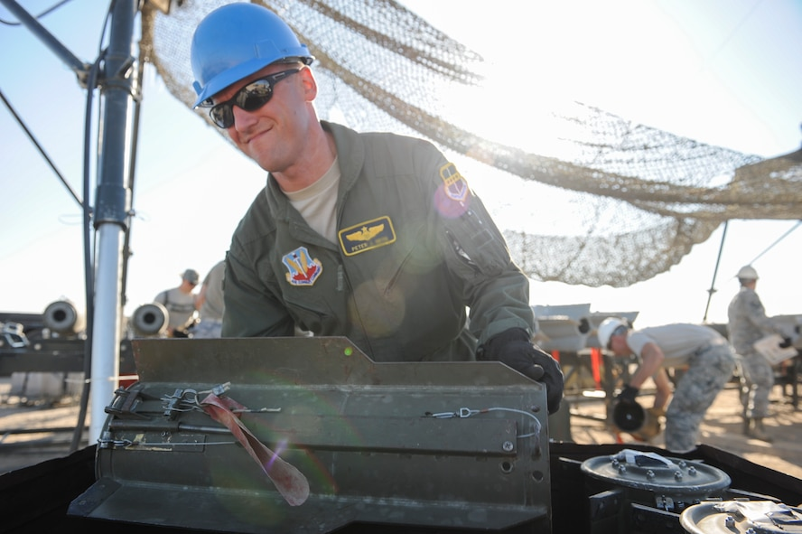 Maj. Peter, a participant in the Senior Officer Orientation course, lifts a tail fin out of a storage container which will be attached to the main body of an MK-82 at Beale Air Force Base, California, Aug. 30, 2017. Guided bomb units can used in conjunction with multiple delivery systems to include infrared, laser, and satellite guided systems. (U.S. Air Force photo/Senior Airman Justin Parsons)