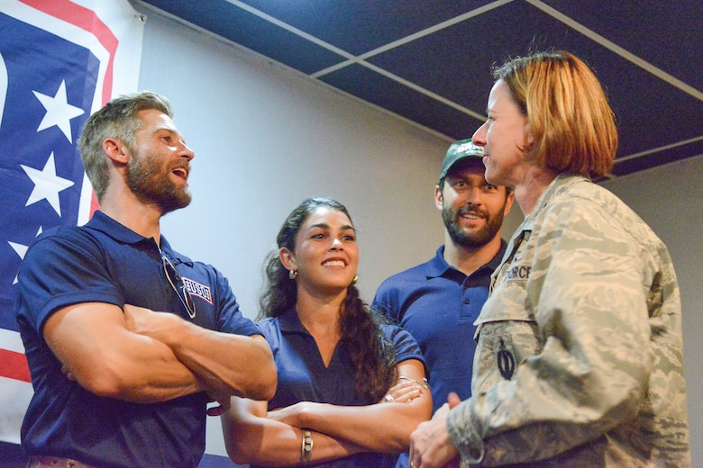 "From left, ""The Brave"" cast members Mike Vogel, Natacha Karam and Noah Mills speak with 377th Air Base Wing Vice Commander Col. Dawn Nickell on Sept. 8 at the Mountain View Club."