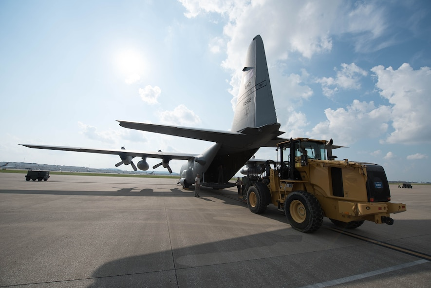 Airmen from the 123rd Airlift Wing load equipment and vehicles onto a C-130 Hercules aircraft at the Kentucky Air National Guard Base in Louisville, Ky., Sept. 20, 2017. The cargo will be used by members of the 123rd Special Tactics Squadron, who deployed to the Caribbean on Sept. 20 to conduct relief operations in the wake of Hurricane Maria.