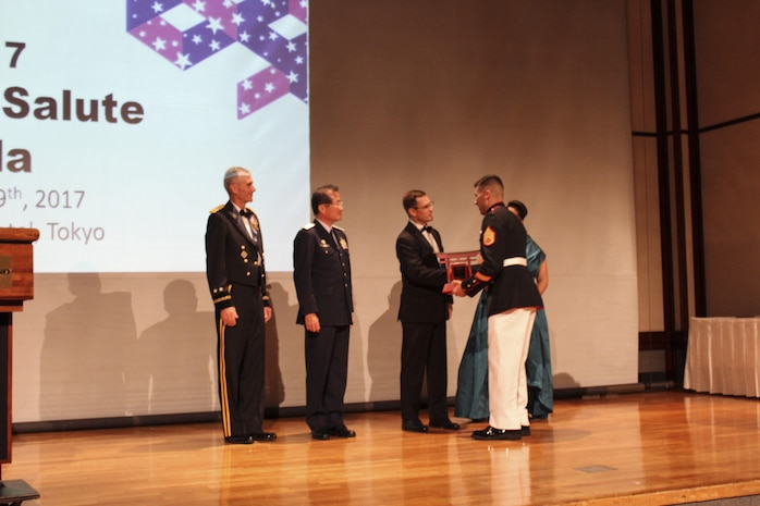 US Marine exceeds expectations, accepts award