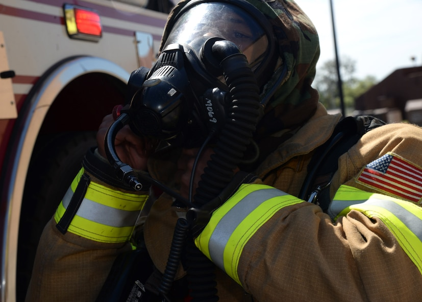 Airman Marcus Gray, 51st Civil Engineer Squadron firefighter, dons his gas mask before responding to a simulated building fire during exercise Beverly Herd 17-3 at Osan Air Base, Republic of Korea September 20, 2017. The exercise was held to evaluate how well base units provided emergency support while defending assets and personnel in a hostile chemical, biological, radiological and nuclear environment. (U.S. Air Force photo by Tech Sgt. Ashley Tyler)