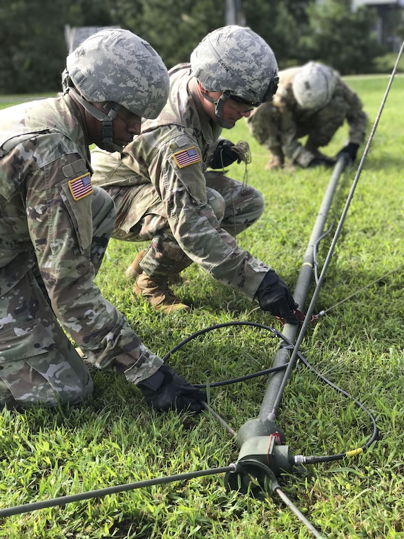 "U.S. Army Soldiers assigned to the 558th Transportation Company, 10th Transportation Battalion, 7th Transportation Brigade (Expeditionary) assemble an OE-254 radio antenna during the company's first ""Maintenance Rodeo"" competition at Third Port, Joint Base Langley-Eustis, Va., Sept. 20, 2017"