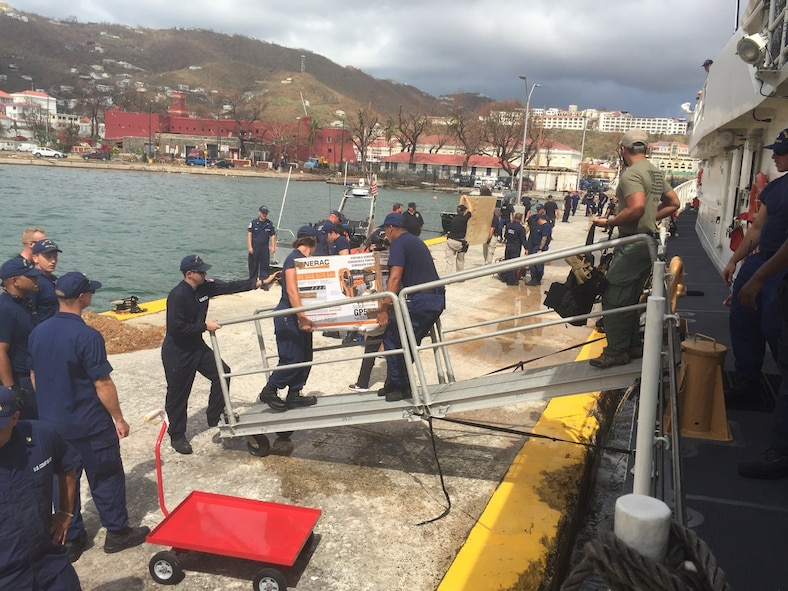 The Coast Guard Cutter Joseph Tezanos crew offloads supplies, equipment and emergency personnel to assist the residence of St. Thomas, U.S. Virgin Islands after Hurricane Irma, Sunday, Sept. 10, 2017.