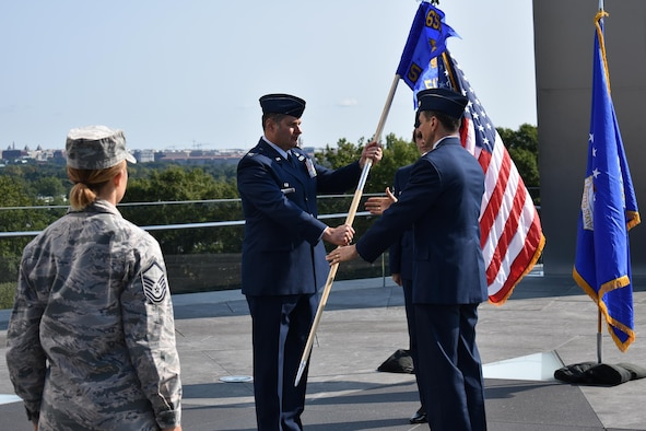 Lt. Col. Todd A. Borzych (right) assumes command of the 512th Cyber Intelligence Squadron,  655th Intelligence, Surveillance and Reconnaissance Group, by accepting the squadron flag from Col. John D. McKaye, 655th ISRG commander, during a formal ceremony September 10, 2017, at the Air Force Memorial in Arlington, Virginia. The 512th IS officially activated on September 2, 2017 along with the 655th ISRG 23rd IS (Cyber), Texas, and 820th IS (Targeting), Nebraska. (U.S. Air Force photo by Maj. John T. Stamm)